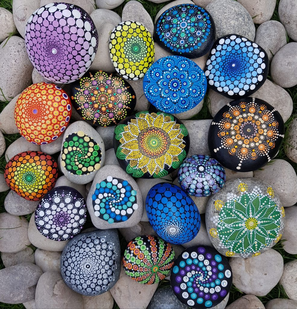 colourful mandalas on stones
