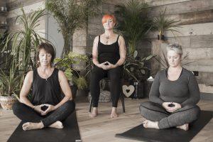 women meditating in a yoga studio