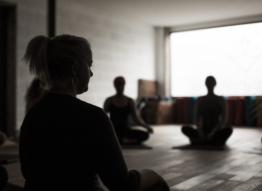 woman leading a meditation circle