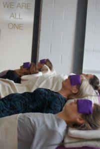 people meditating in yoga nidra