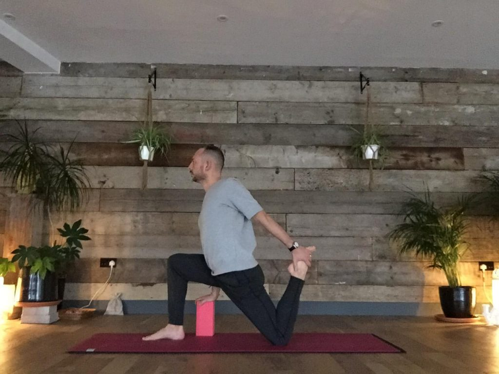Daniel Groom demonstrating rear foot elevated lunge in yin yoga