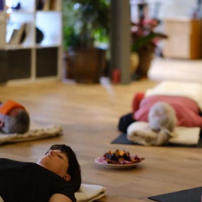 people meditating on yoga mats